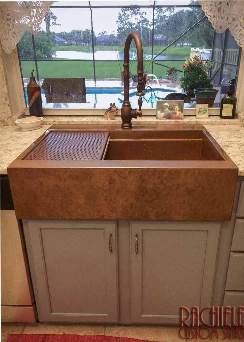 copper sink farmhouse design in a large kitchen