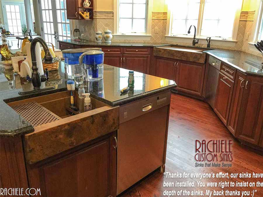 Two copper farmhouse sinks in one kitchen