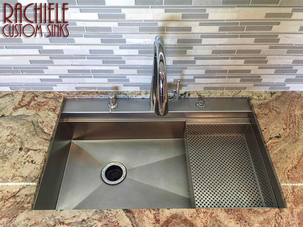 Stainless undermount kitchen sink with rear deck for faucet.